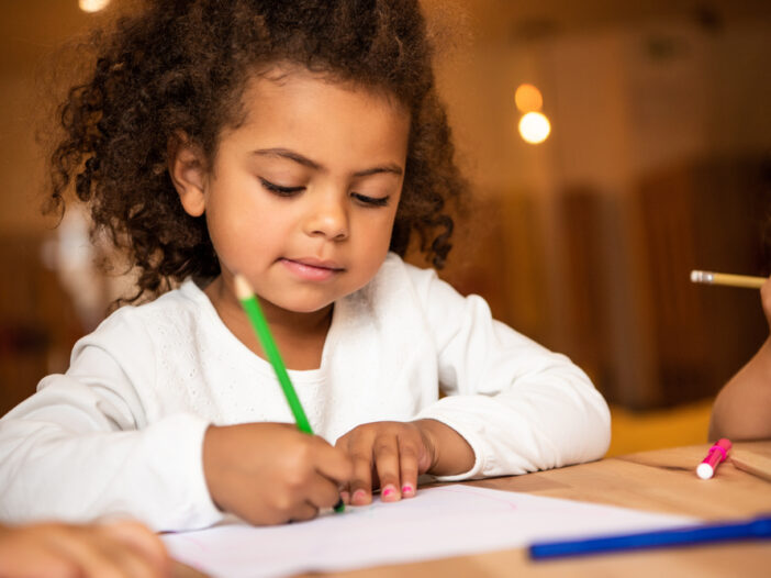 Young girl doing her kindergarten readiness checklist