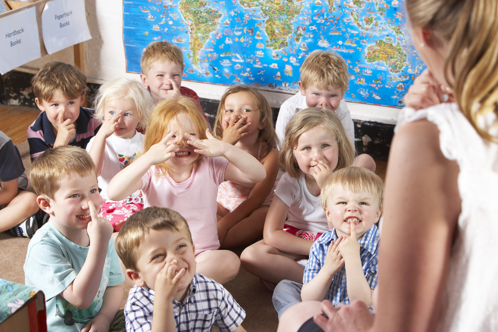 Teacher preparing kids with kindergarten readiness