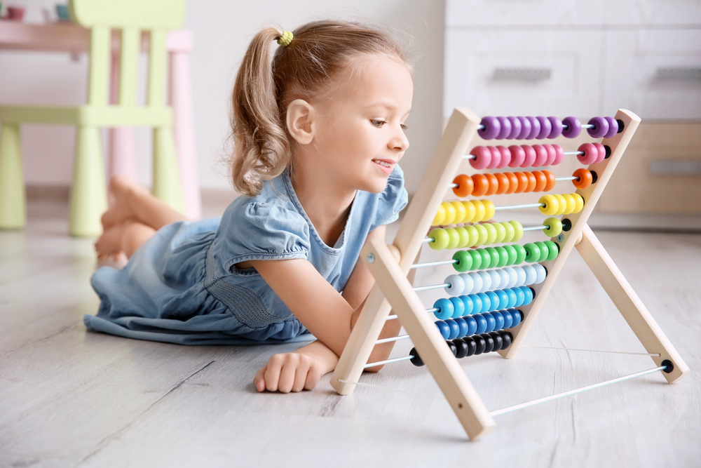Girl doing math activities for preschoolers
