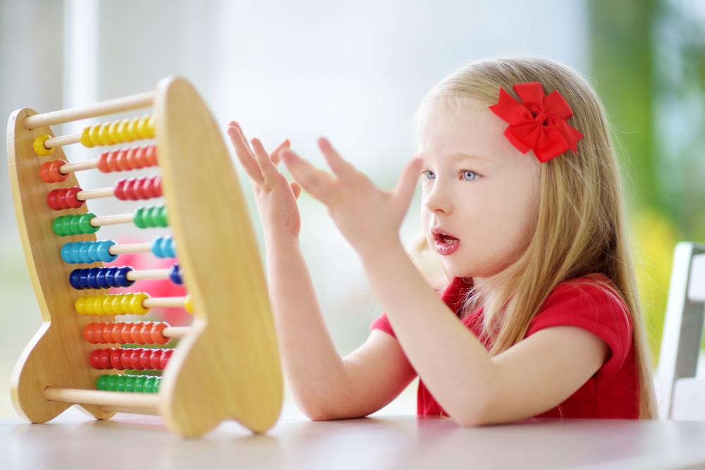 Young girl playing preschool math games