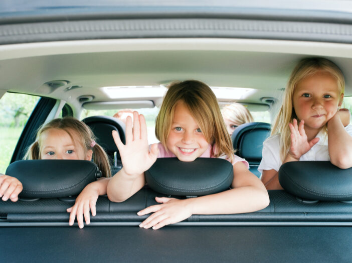 Kids getting ready for a road trip