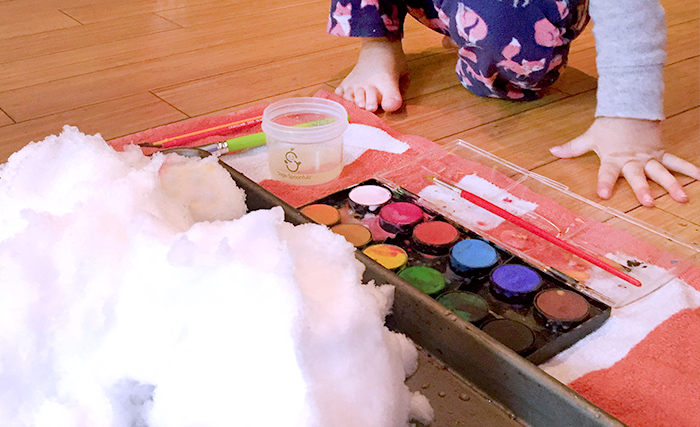 A fun winter indoor activity is to paint the snow.